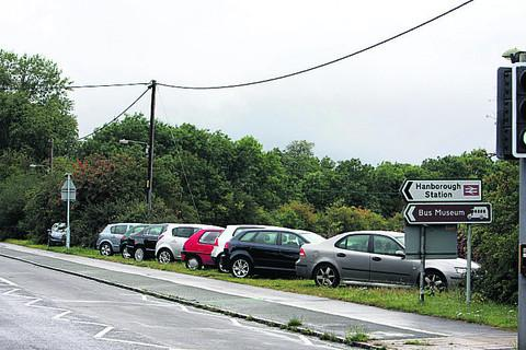 Cars line the verges  outside Hanborough Station