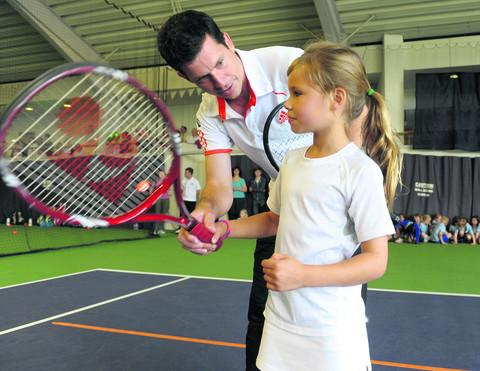 Tim Henman coaches Ines Braithwaite, eight at the Abingdon sports centre