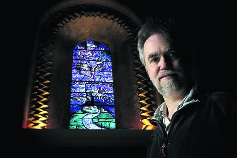 The new window and its creator, artist Roger Wagner, at St Mary's Church, Iffley