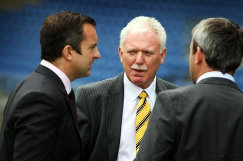 Ian Lenagan in conversation with his sons Adrian (left) and Simon on the Kassam Stadium pitch yesterday after announcing he will assume overall responsibility of Oxford United. All three are on the board of directors