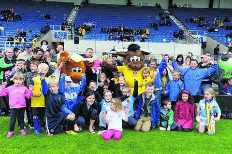 Young fans with Ollie the Ox and his female companion Olivia