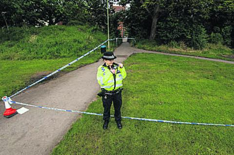 Police guard an area of The Kinecroft, in Wallingford