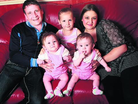 Andrew and Emily Hunt with Jessica, three, and twins Madison and Tabitha