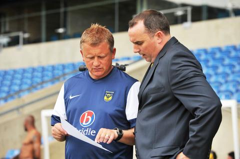 Former Oxford United chairman Kelvin Thomas (right), pictured with manager Chris Wilder, believes the U's American tour represents good value to the club