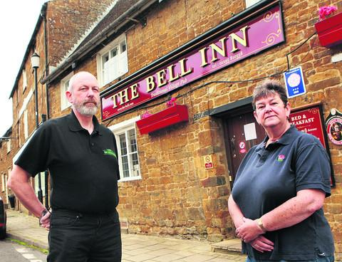 Former publicans John and Trisha Bellinger outside their old pub, the Bell, in Adderbury