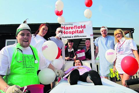 Sam Burbridge, Elaine Earnshaw, Sean Murray, Yvonne Earnshaw, Tina Merriless, Sandy McCracken and Joy Porterhouse get ready to push Caroline Earnshaw, who has a rare genetic heart disease, around the pubs of Bicester in a hospital bed to raise money for H