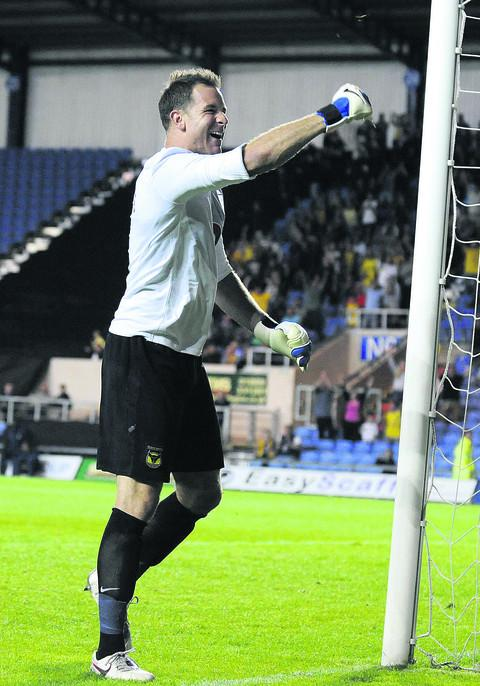 Ryan Clarke celebrates his penalty save