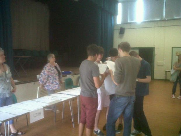 Pupils at John Mason School in Abingdon start opening their A Level results