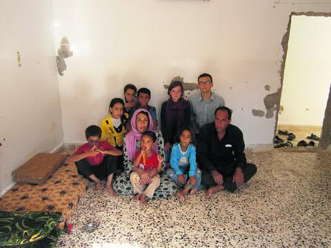 Thomas and Abigail Stocker with Syrian refugee Mohammed and his family in Mafraq, Jordan