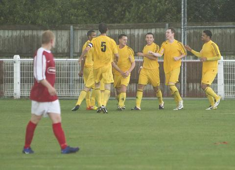 Matty Biddle is mobbed by his teammates after giving Abingdon United the lead in their derby game at Didcot Town, only to lose 2-1