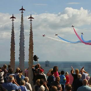 The RAF Red Arrows perform above a memorial to Reds' pilot Flight Lieutenant Jon Egging who died in a crash