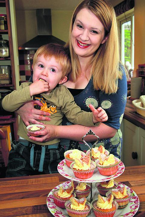 Anneleise Giggins  and two-year-old Isaac tuck into some butterfly cakes