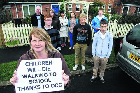 Pauline Preece, front left, with parents and their children who are angry about changes to free bus passes which have been issued to some students at Wallingford School but not to others