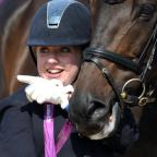 Golden girl Natasha Baker poses with her horse, Cabral