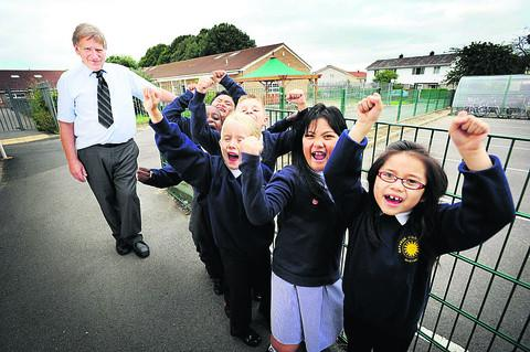 Headteacher Keith Ponsford with excited pupils, from left, Jhedrick Navarro, Ryan Njoroge, Ella Stevens, Camron Curry, Celinna Amigo and Mikyla Avila. Picture: OX54128 Richard Cave