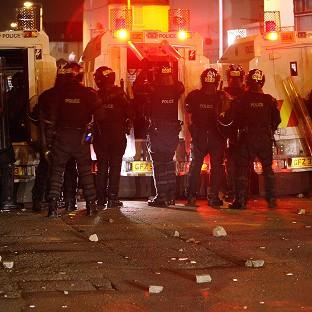 Police come under attack at Carlisle Circus in north Belfast in a third night of disturbances in the city