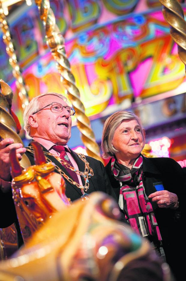 Last year's Witney mayor Harry Eaglestone and his wife Georgina on the gallopers at the 2011 Witney Feast
