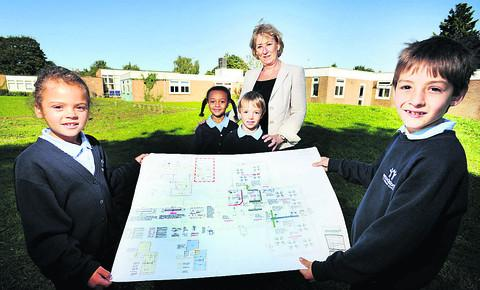 Woodstock Primary headteacher Lisa Rowe shows the plans to pupils, from left, Summer Davis, Libbie Blackstock,Tom Waiter, and James Kusek