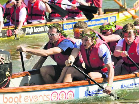 Silver medalists Richard, left, and Peter Chambers, right front, joined the competitors with paddles