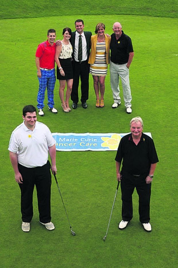 Back, from left, golf day organisers Leanne Lovegrove, Ian Lovegrove, David Billington and Angela and Dave White, with, front, winners Aiden McKieran and Dennis McCleese