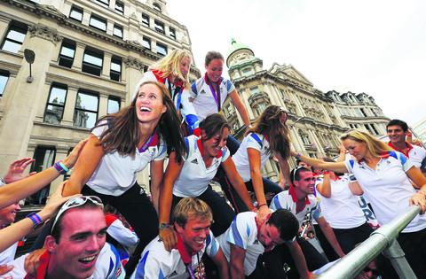 Oxford Mail columnist Caroline O'Connor, who coxed the women's eights, is pictured on top, with Helen Glover, Women's Pair gold medallist, centre left. They were supported by brothers Peter and Richard Chambers, wearing sunglasses, who won silver in