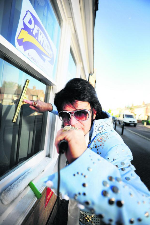 Tim Crysell cleans windows by day and is an Elvis impersonator by night