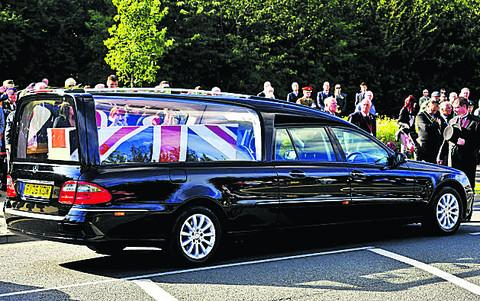 The body of Sergeant Lee Davidson, inset, arrives at RAF Brize Norton
