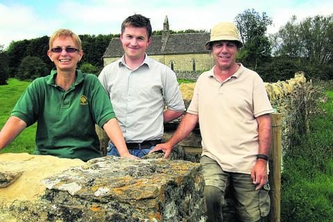 Jane Bowley, from the Wychwood Project, pictured with David Malloy, centre, rural crafts officer for the Cotswold Conservation Board and supervising dry stone waller Trevor Townsend