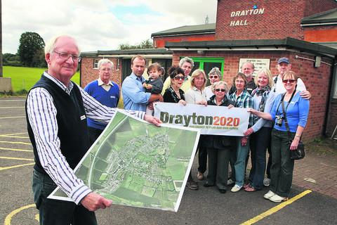 Andrew Bax, chairman of Drayton Community Trust, and villagers involved in the scheme