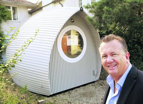 Businessman Robin Swailes with a pod