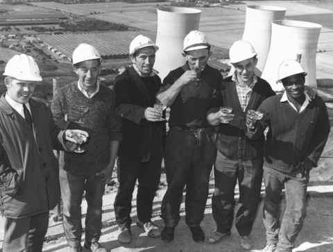 This group of workers at Didcot Power Station celebrate to mark the completion of their work on the chimney in 1968