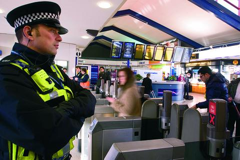 Pc Bob Burrowes on duty at Oxford railway station, which has seen a fall in crime since British Transport Police moved back there in January 2011
