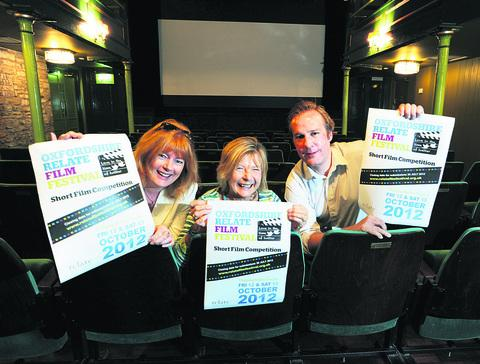Relate client Clare Hunt, left, Sue Trevor-Wilson and Stephen Birch from the Chipping Norton Theatre with posters publicising the Relate film festival