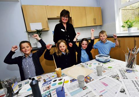 Headteacher Jane Holt, pictured in the cookery and art area with pupils, from left, Chloe Westbury, Bella Wigzell, Anna Cavendish and George Westbury. Picture: Mark Hemsworth