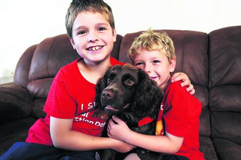 Nine-year-old Steven Courtney with Molly and his younger brother Charlie