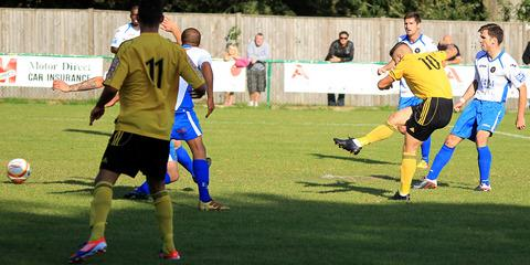 Kieran Sanders fires home North Leigh's winning goal