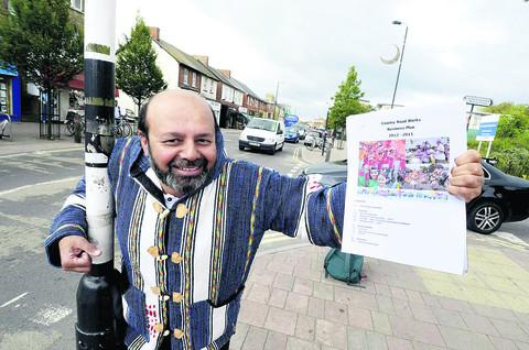 Carnival book-keeper and trustee Zaheer Qureshi with the business plan for next year's event
