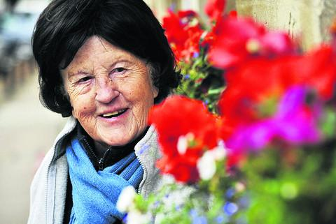 Pauline Richardson with the flower displays in Woodstock that won