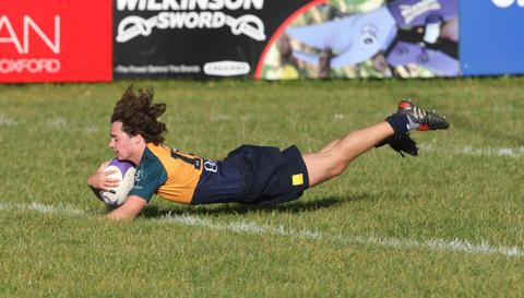 Oxford Harlequins fly half Joey Todd goes over for an interception try during their 73-15 defeat to London Irish Wild Geese