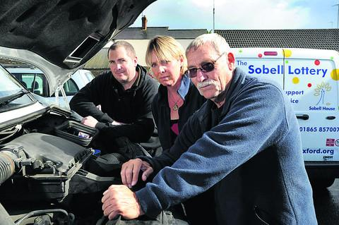 From left, Mark Gower, of Spires Auto Centre, Louise Musgrove, Sobell's trading manager, and Michael Barrett, the charity's warehouse manager