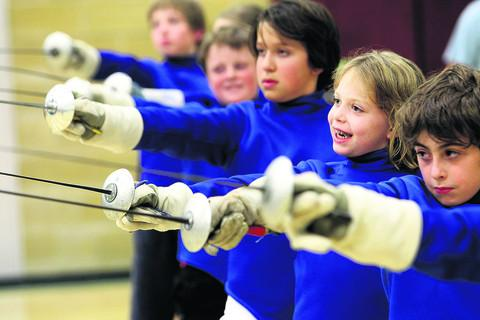 Junior fencers take the salute at Abingdon Fencing Club, which is receiving two or three requests a week to join its junior section. Pictures: OX54759 Ric Mellis