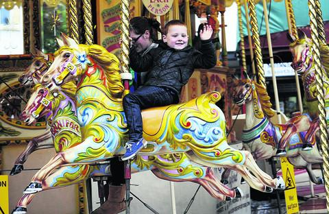 Bobbi-Ty Wilkins, four, on the carousel