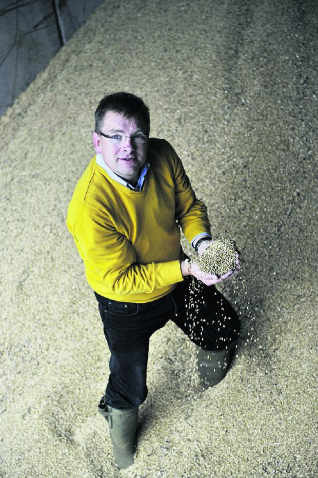 Farmer Mike Gooding with his reduced wheat yield