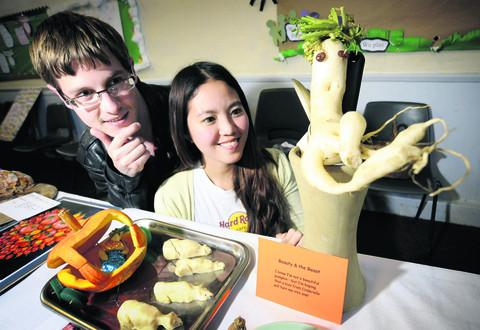 Sam Marshall, 25, and Shirlyn Low, 26,  study one of the unusual vegetables on show.