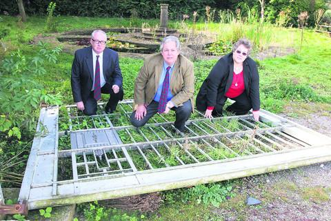 From left, councillor Kieron Mallon, Sir Tony Baldry MP and Sarah Jarvis with the remaining gate