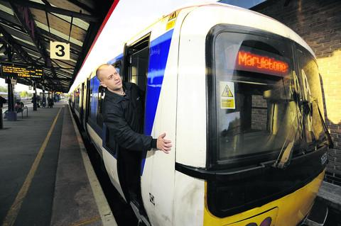 Banbury train driver Richard Smith checks the destination on the front of a train at Oxford station