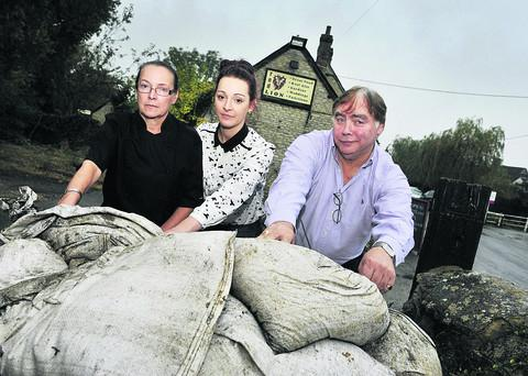 From left, Sally Jenkins, her daughter Sophie Jenkins, 19, and Joe Whitelaw at the Red Lion pub in Main Street, Wendlebury. Main picture: Mark Hemsworth