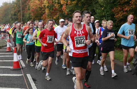 Runners pass colourful foliage during their race through Abingdon.