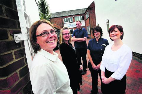Left to right, staff members Louise Normington, Deb Morris, George Allen, Mandy Jerams and Lauren Mullins outside the new dental practice in East Oxford
