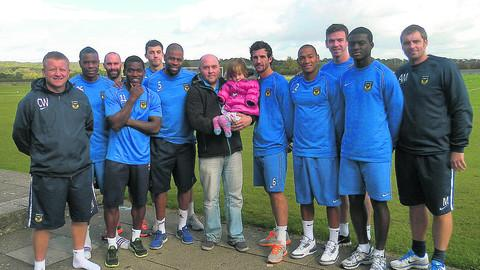 Alex and Charlotte Nott (centre) are joined by Oxford United's players to support the walk